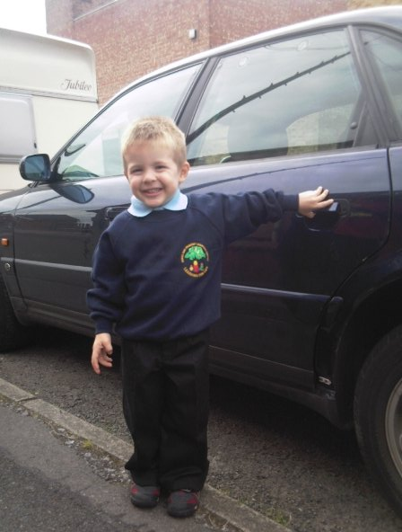 All ready for his first session at Pre-School aged three and a half
