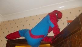 Spiderman doing what only he knows how!